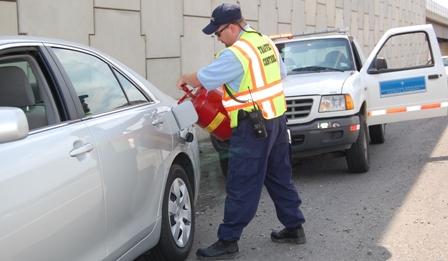 Patrolmen filling car with gas