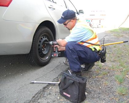 Patrolmen Fixing Wheel